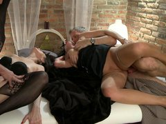 Young and old swinging couples having sex