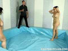 Two fat ladies wrestling naked for cock