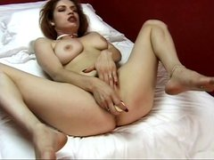 Perky tits brunette poses on bed while spreading her pink pussy lips