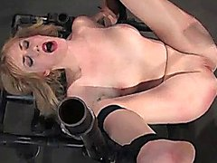 Strapped to metal device blonde fucked