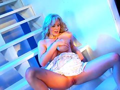 Naughty girl sitting on the stairs