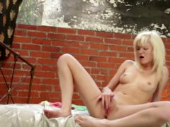 Adorable babe fingers her pussy