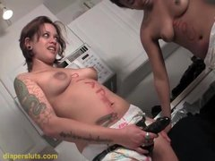 Strapon blowjob with two girls in diapers