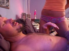 Young blonde climbs in bed with older guy