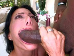 Zoey Holloway is a sexy dark haired milf she pulls