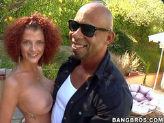 Curly haired redhead Joslyn James shows off her giant tits