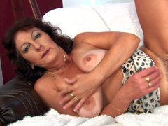 Granny Alma is horny again. Aged brunette with big tanlined