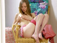 Slender teen girl Gloria in stockings and crotchless panties spreads