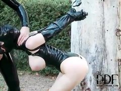 Latex fetish girl bound and sucking strapon
