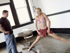 Bespectacled blonde girl Jai Cee Simpson does the splits and