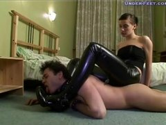 Girl in tight leather pants dominates him