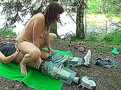 Babe with big boobs riding a fat cock outdoors