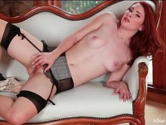 Seamed stockings on this milky white redheaded babe