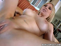 Cute big titted blonde Christie Stevens gets naked and spreads