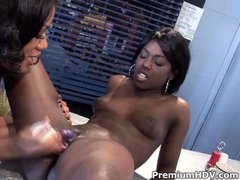There are two dark skinned lesbians having lesbian sex. Angel