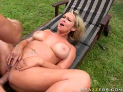 Delicious big titted blonde Abbey Brooks is naked and exposes