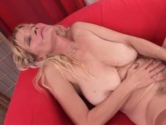 Horny granny shoving dildo down her hairy snatch