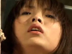 Asian girl in suspension whipping-002