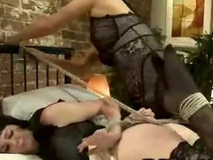 Brunette babe tied up and fucked by blonde tranny in stockings in bed