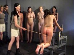 A girl is very badly caned on the ass