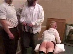 She is spanked and she is caned hard