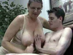 Busty mom in glasses gives handy to teen guy