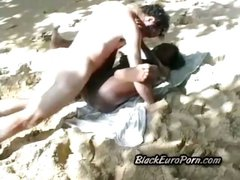 Filthy black babe takes horny white perv at the beach