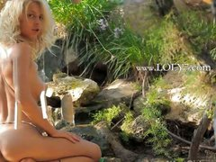 Amazing wow girl stripping in a forest