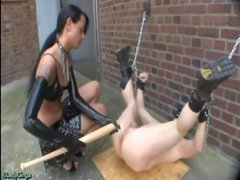Brunette mistress Lady Ginga does some dildo work on her slave