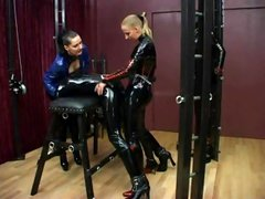 German brunettes Stella and Silvia in latex torture their slave