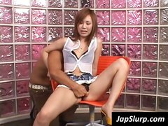 On a red chair a young Asian orally pleasures a guy's pole
