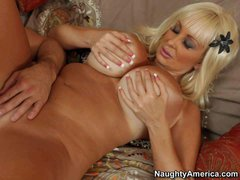 Golden haired and really busty milf Brittany O'Neil enjoys in