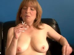 Mature blonde lady getting naked as she enjoys a smoke