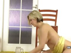 Dirty babe sucks and rides a piss filled sex toy