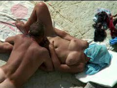 Couple at the beach gets mighty frisky