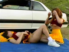 After the game Blair Segal and her co-cheerleader hook up with the quarterback by the car