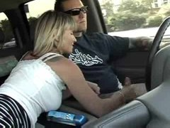 Adventurous milf jerks him off in the car