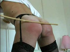 Girl in stockings caned on her ass
